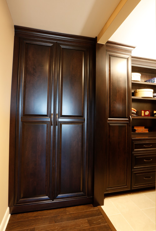 Armoire on casters hides second door into condo
