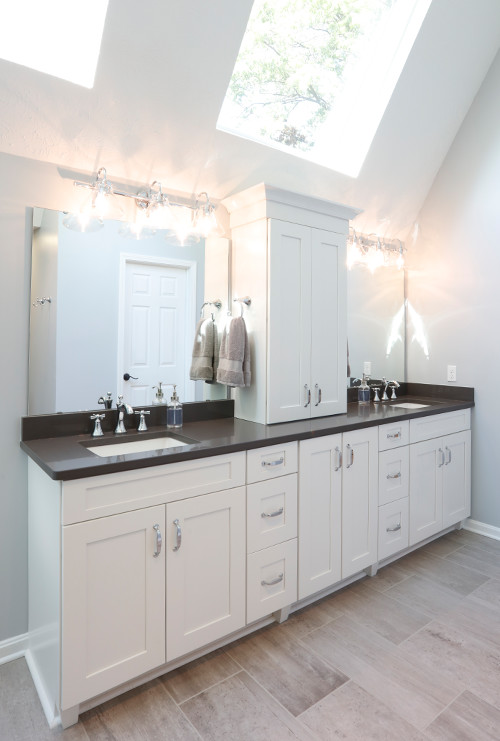 His-and-hers vanity with white shaker cabinets and sleek grey quartz countertops