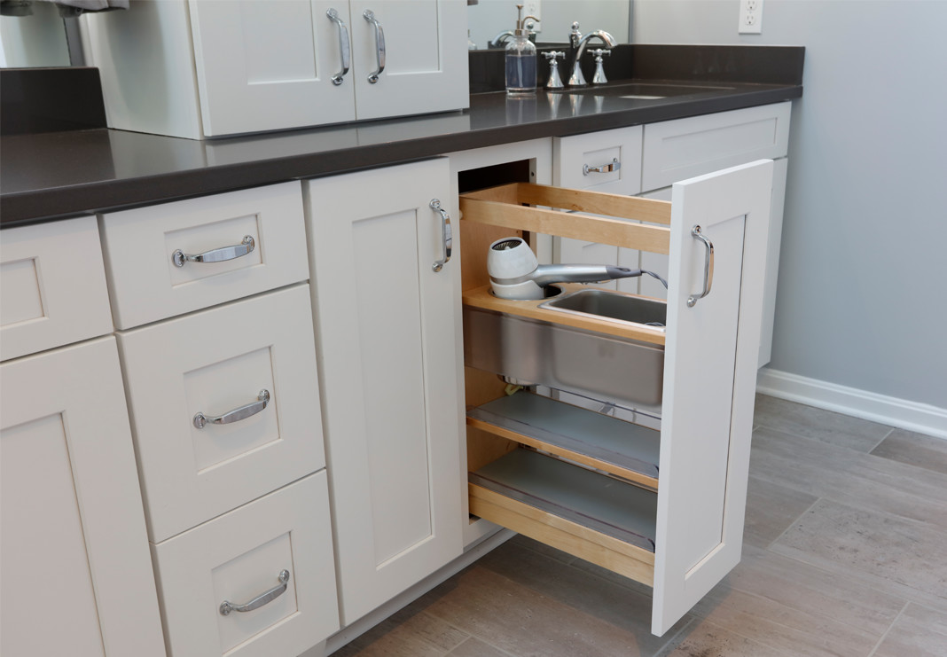 Salon style cabinetry with curling iron and hair dryer outlets built in