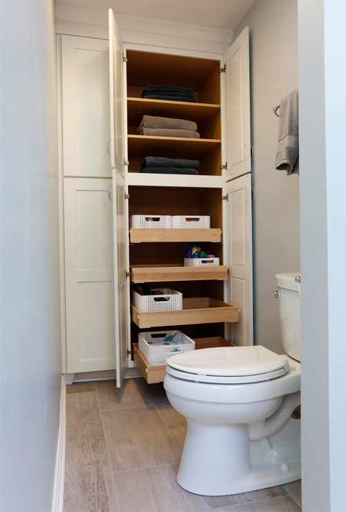 spacious floor-to-ceiling linen closets with pull-out drawers for lots of added storage