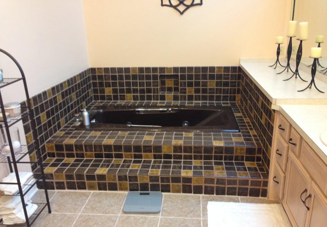 Dark Bathroom Tile and Tub - Before Photo