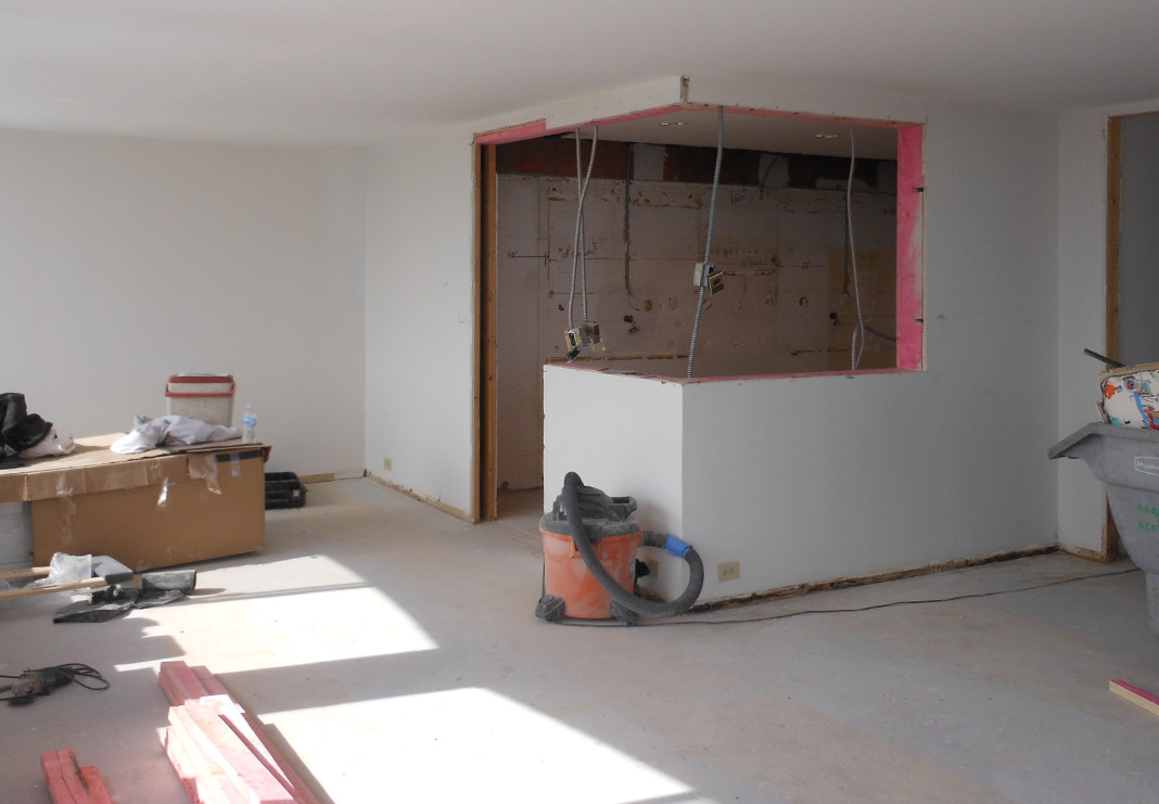 Partial Removal of Kitchen Wall to Open up Space - During Photo