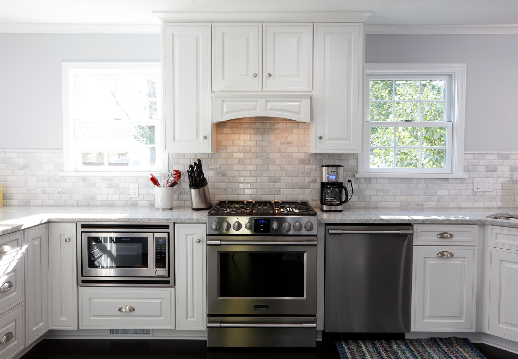 Slide in Range with Decorative Hood and Tile Backsplash