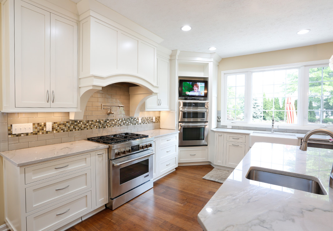 Double Ovens with TV in Custom Kitchen