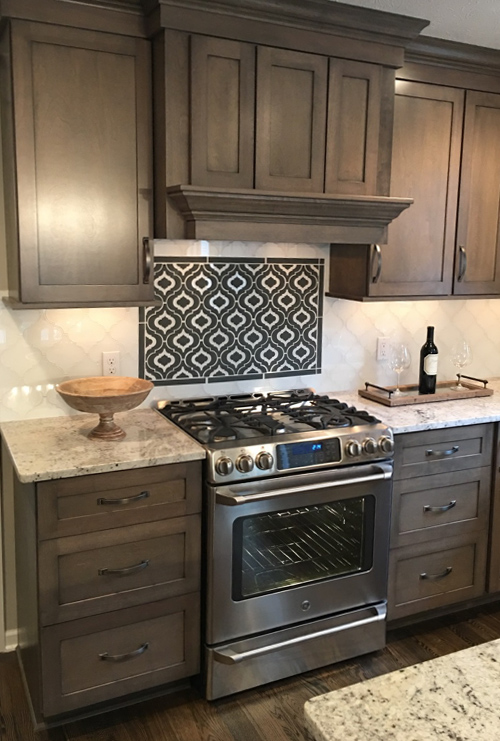 Stove With Glass Tile Backsplash