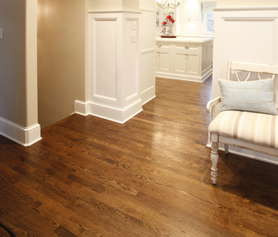 Home with hardwood floor with white trim