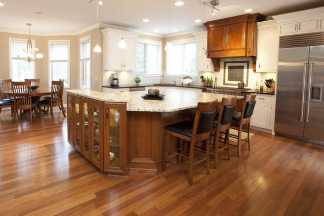 Remodeled kitchen with hardwood floor and coordinating island