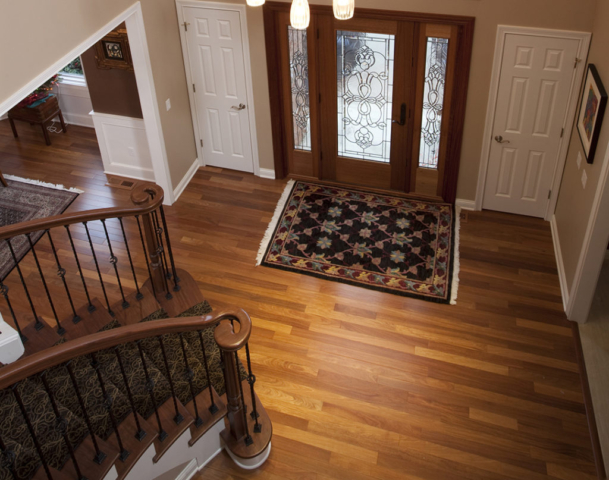 Two-story foyer with beautiful hardwood floor