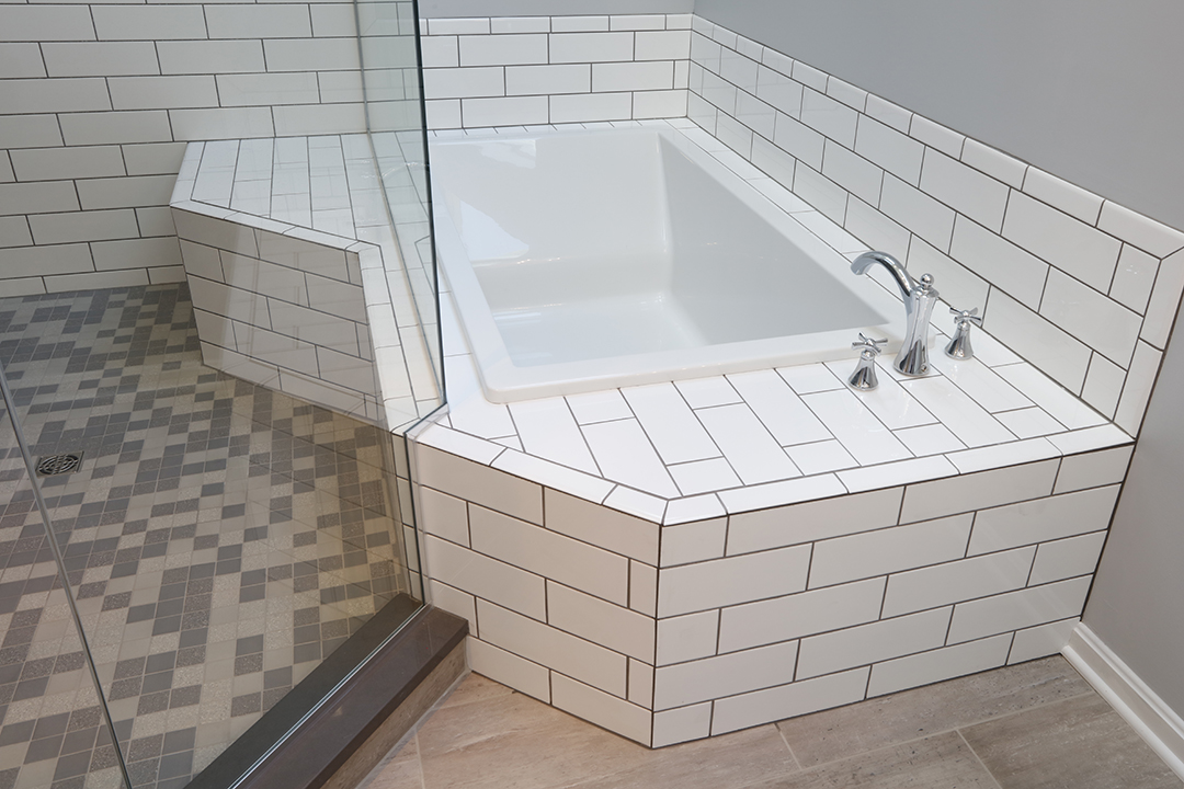 Variety of tile used in bathroom for floor, tub deck and shower enclosure