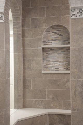 Shower room with wall, floor and accent tiles in coordinating color palette