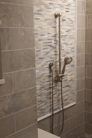 Accent tile inlay in custom shower room