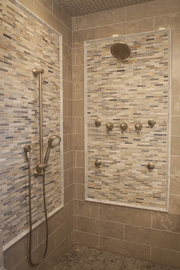 Coordinating floor, wall, ceiling and accent tiles in custom shower room