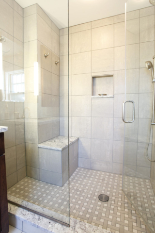 Coordinating wall and floor tile in walk-in shower