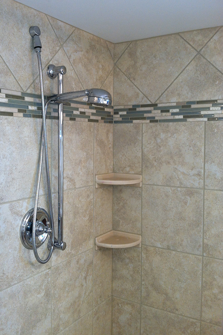 Decorative accent tile in shower enclosure