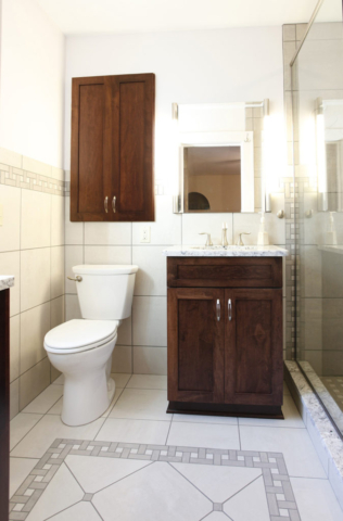 Bathroom with custom tile on floors and walls