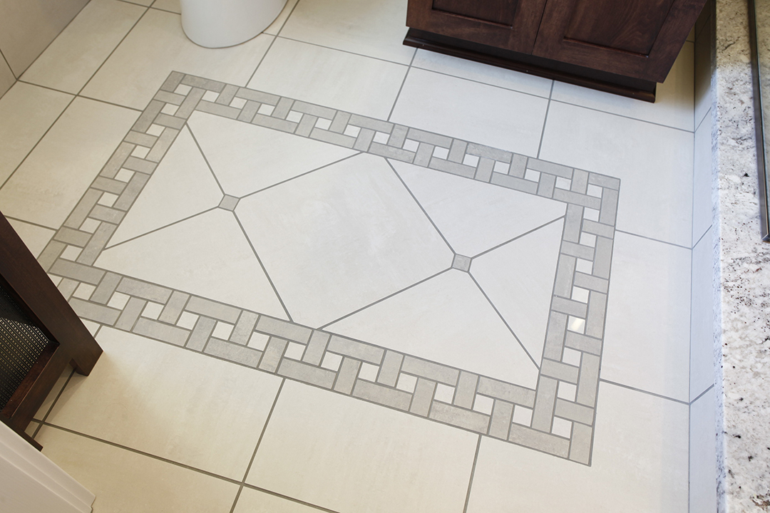 Decorative tile floor in bathroom