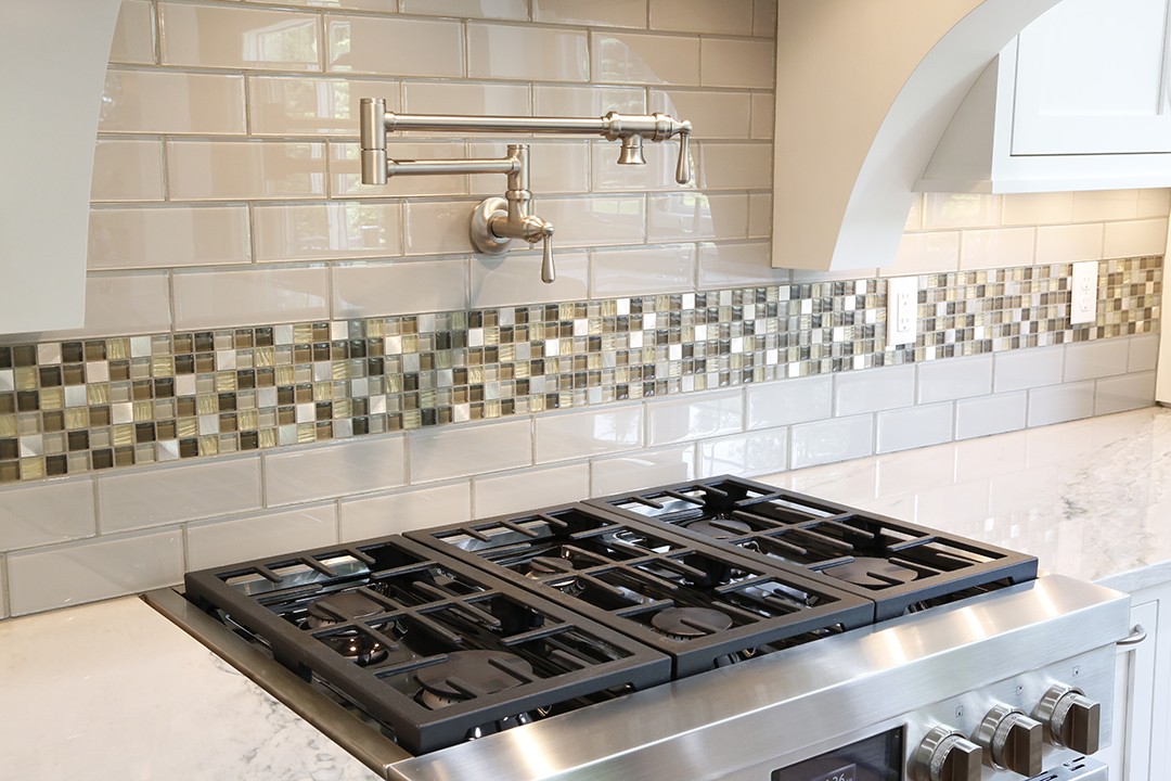 Kitchen backsplash with subway tile and mosaic accent tile