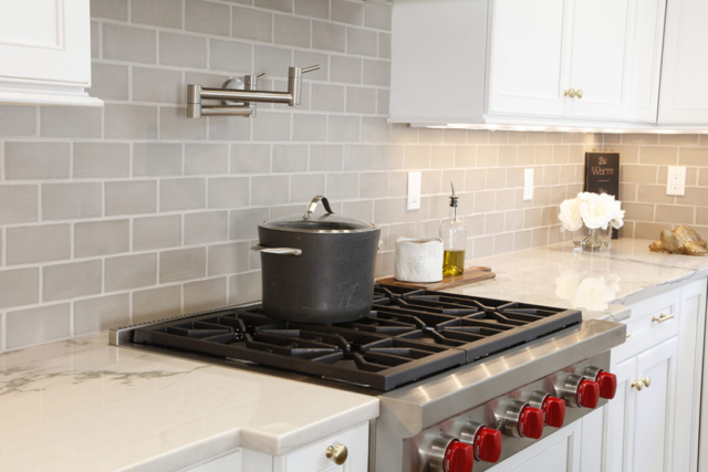 Kitchen remodel with light gray tile backsplash