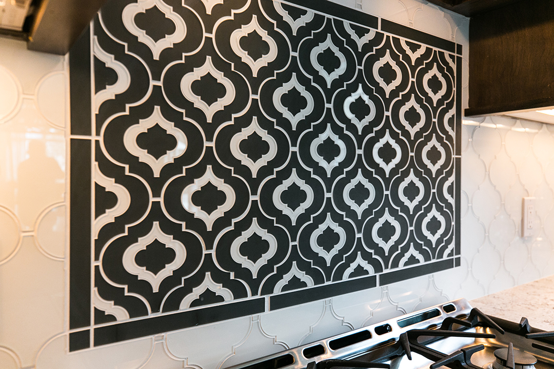 Art glass tile inlay creates focal point in kitchen