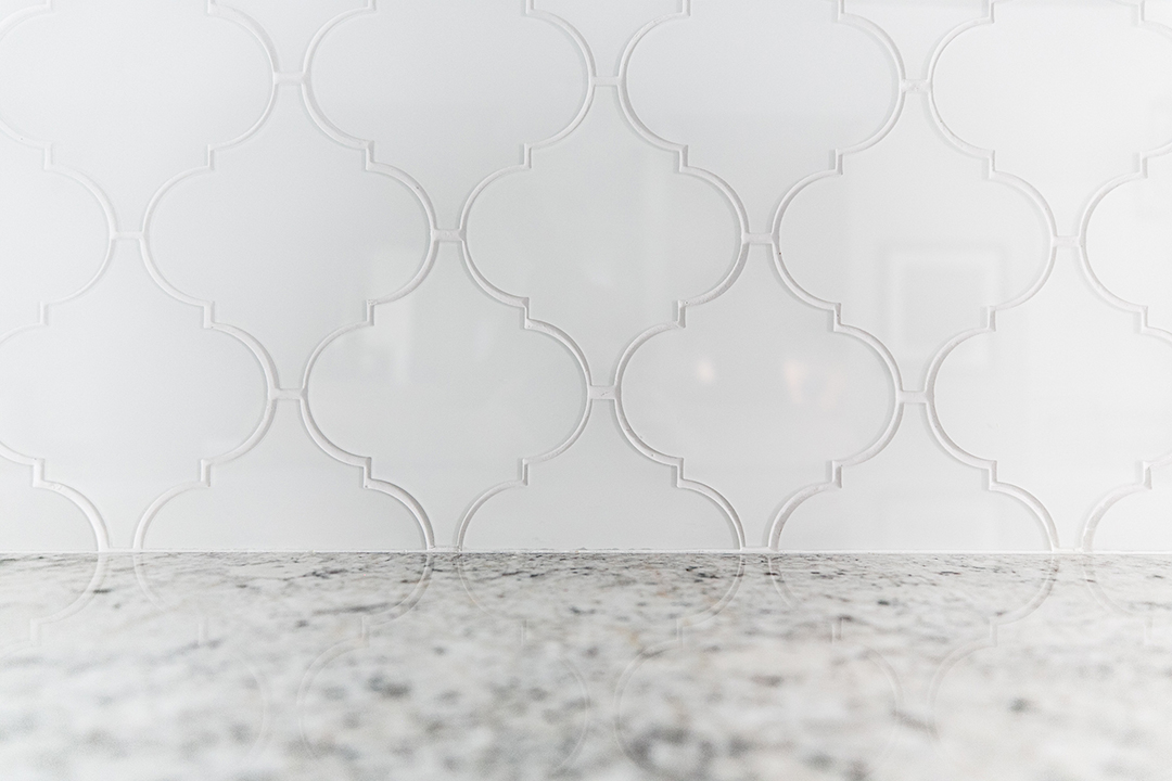 Unique shaped glass tile used for kitchen backsplash
