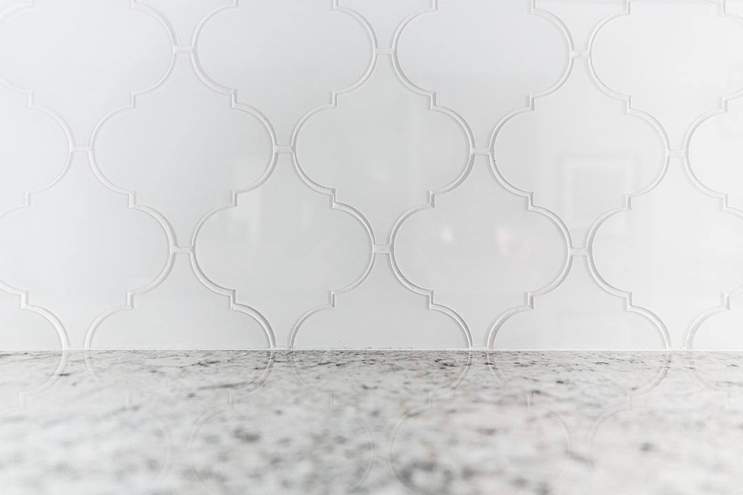 Unique shaped glass tile used for kitchen backsplash
