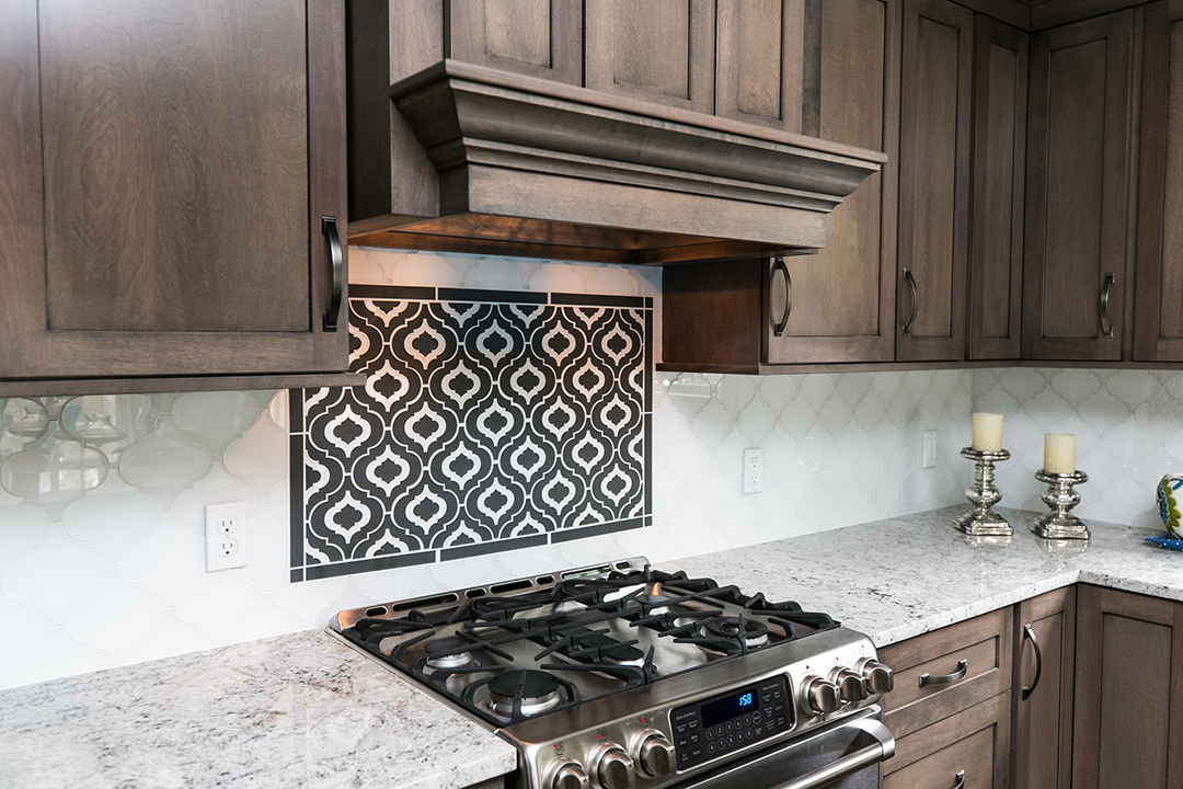 Art glass tile backsplash in kitchen with black and white focal point