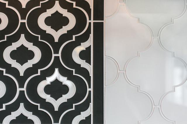 Kitchen backsplash with custom glass tile inlay