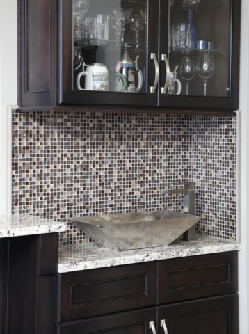 Mosaic tile backsplash accents wet bar area