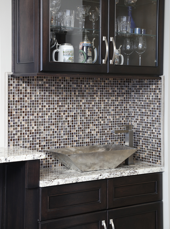Mosaic tile backsplash accents wet bar area
