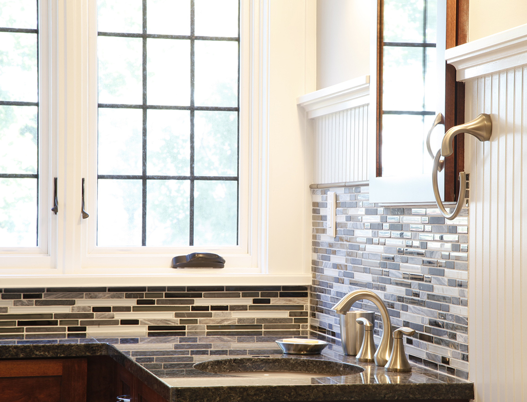 Custom tile backsplash in bathroom remodel