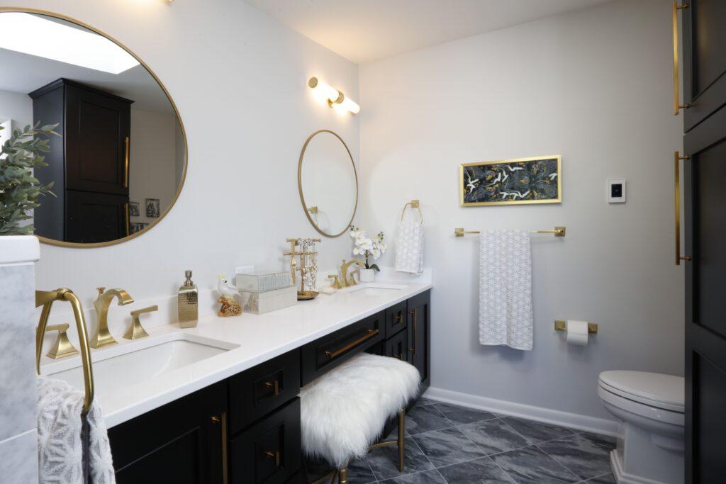 Matte gold bathroom fixtures add glam to a minimilistic room