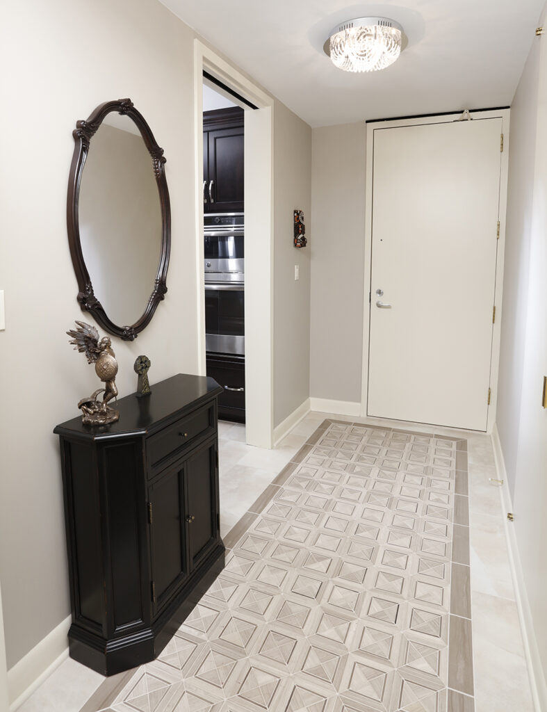 Tile with inlay design in hallway
