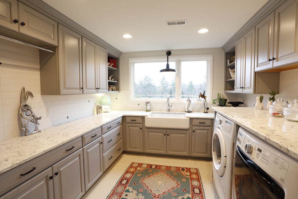 Laundry room with storage and farmhouse sink