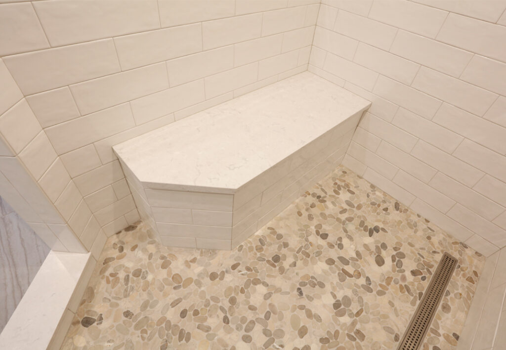 built in shower seat with custom tile