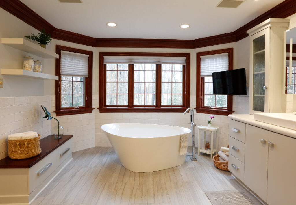 freestanding tub with tile flooring