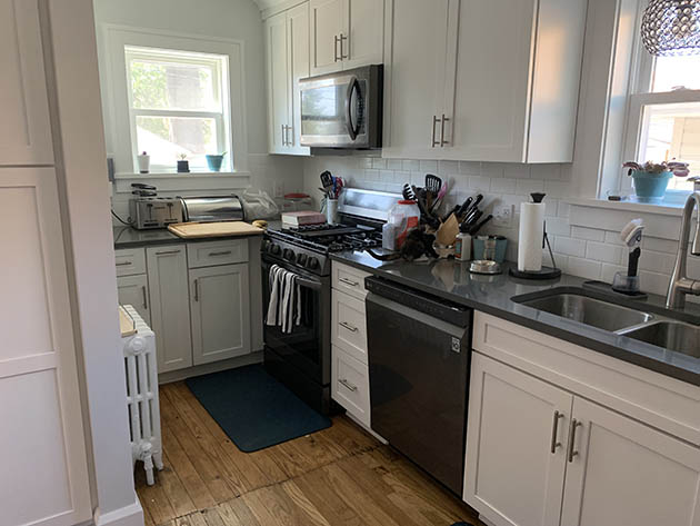 kitchen after remodeling showing built in microwave